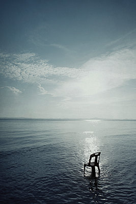 Chair in the sea - p1240m2063345 by Adeline Spengler