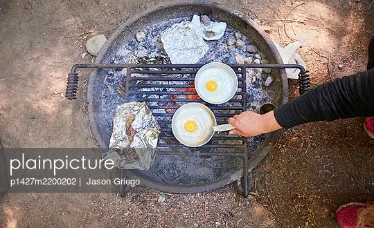Preparing breakfast at camping - p1427m2200202 by  Jason Griego