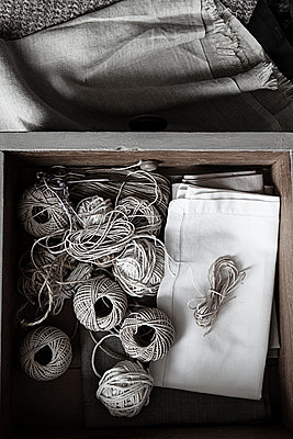 Balls of string and linen in drawer - p1470m2055111 by julie davenport