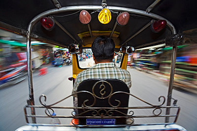 Tut-tuk taxi ride through the streets of Bangkok - p6521704 by Andrew Watson