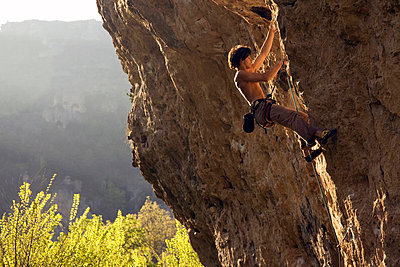 A climber tackles a very difficult route on the rock known - p8713177 by David Pickford