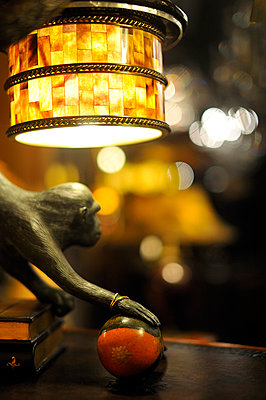 lampshade and monkey - p1047m789458 by Sally Mundy
