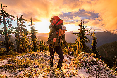 Backpacker hiking on mountain summit, Whistler, B.C. - p1166m2255896 by Cavan Images
