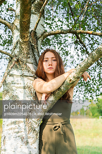 Girl under a birch tree - p1609m2254078 by Katrin Wolfmeier