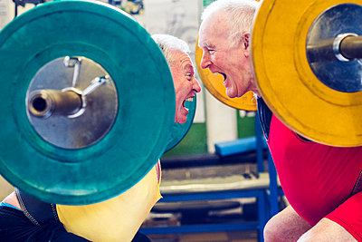 Two senior powerlifters face to face, shouting - p429m1504588 by Emmerich and Webb