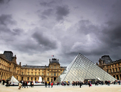 Louvre Museum and pyramid under stormy sky - p1072m829297 by Neville Mountford-Hoare