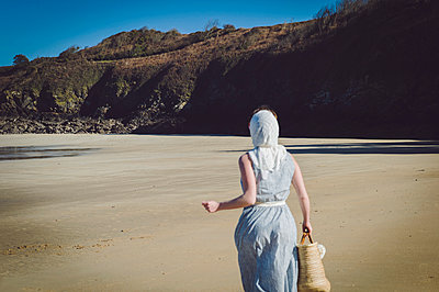 Woman in summer dress running on the beach - p1150m2260475 by Elise Ortiou Campion