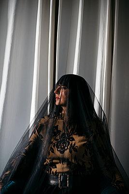 Woman with black veil  - p1621m2228882 by Anke Doerschlen