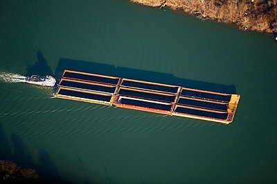 Aerial view of an empty barge on a river - p3433430 by Harrison Shull