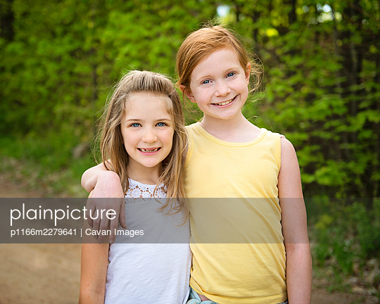 Two Young Girls Exploring Outside - p1166m2279641 by Cavan Images