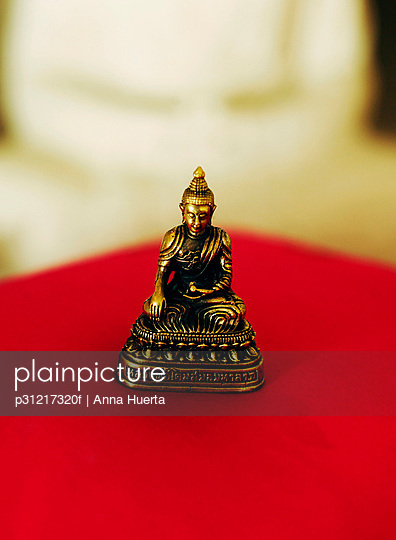 A Buddha symbol.