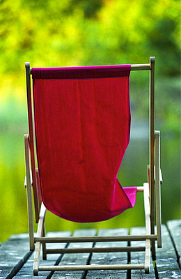 Red deck chair - p1418m1571511 by Jan Håkan Dahlström