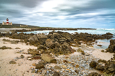 Lighthouse and bay at the southernmost tip of Africa, Cape Agulhas, Western Cape, South Africa, Africa - p871m1480331 by James Strachan