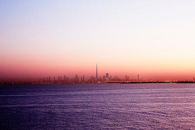 City skyline at dusk - p312m1024775f by Magnus Ragnvid