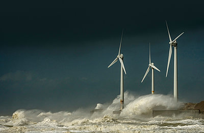 Three wind turbines amidst fierce storm waves and clouds at coast, Boulogne-sur-Mer, Nord-pas-de-Calais, France - p429m1135490f by Mischa Keijser