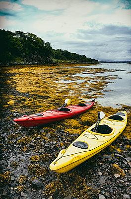 Landscape canoes stony beach seascape coast seaweed nobody - p609m2066451 by WALSH photography