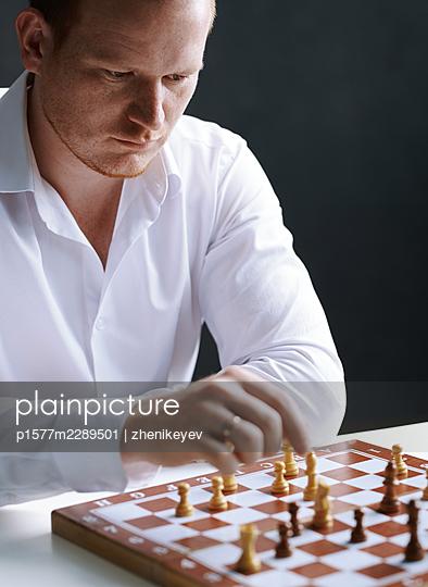 Man playing chess - p1577m2289501 by zhenikeyev