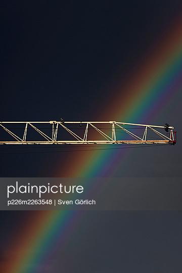Construction crane against rainbow - p226m2263548 by Sven Görlich
