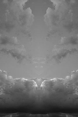 Symmetrical cloudscape, constructed from one half of a photograph and its own mirror image. From art project Symmetry - p1433m2150484 by Wolf Kettler