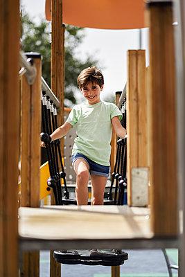 Portrait of smiling little girl having fun on a playground - p300m2029523 by Javier Sánchez Mingorance