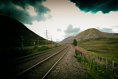 Railway perspective tracks power pylons landscape - p609m1490713 by WRIGHT