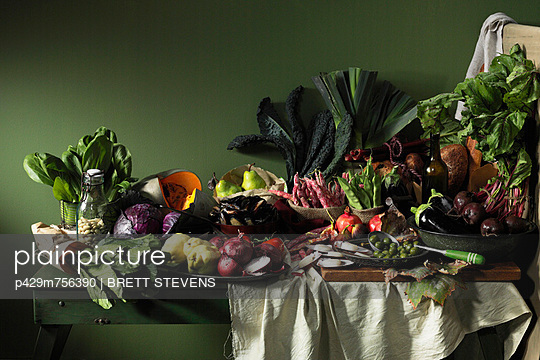 Fruits and vegetables on table - p429m756390 by Brett Stevens