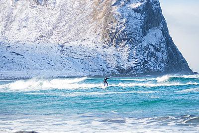 Surfer in Lofoten, Norway - p352m1536563 by Calle Artmark