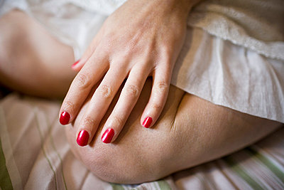Red painted nails - p5350178 by Michelle Gibson