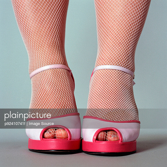 Woman wearing high heeled shoes - p92410741f by Image Source