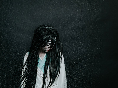 Young woman with long black hair - p1184m1441221 by brabanski