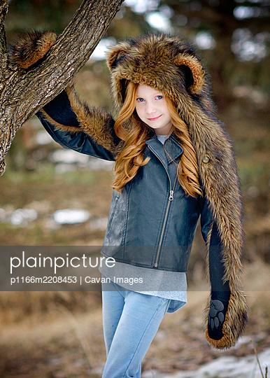 Young Girl Long Red Hair Wearing Bear Spirit Hood - p1166m2208453 by Cavan Images