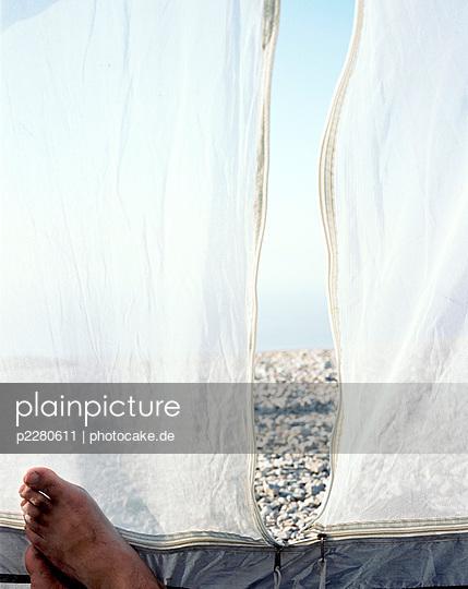 Man in a tent - p2280611 by photocake.de