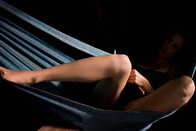 A woman writes in a hammock on Little Corn Island, Nicaragua. - p1166m2096592 by Cavan Images