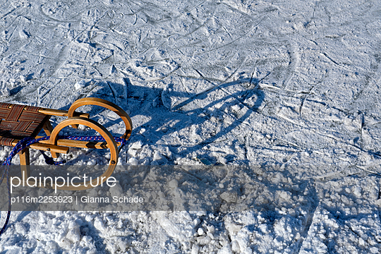 Sledge in the snow - p116m2253923 by Gianna Schade