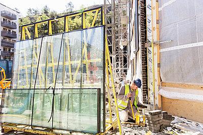 Builder at work - p312m1187840 by Susanne Kronholm