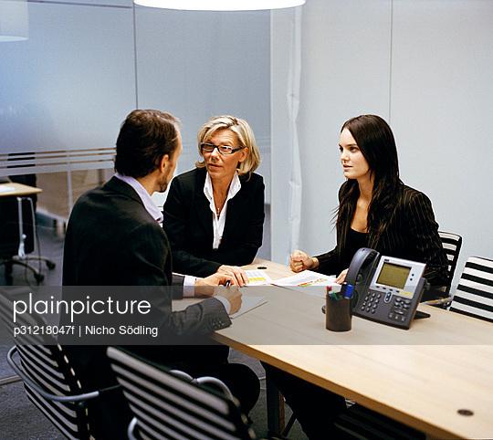 People in an office Sweden.