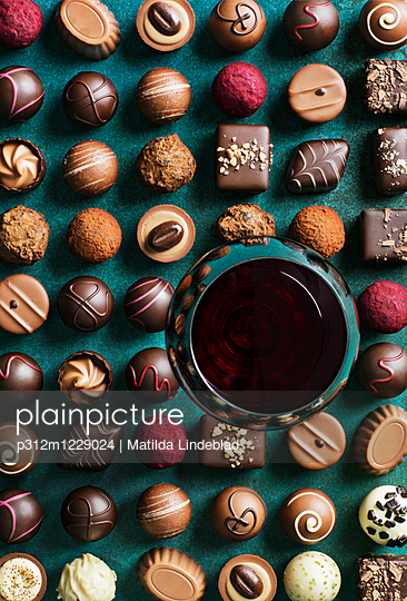 Red wine and various chocolate truffles and sweets