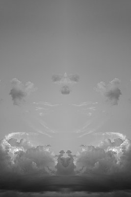 Symmetrical cloudscape, constructed from one half of a photograph and its own mirror image. From art project Symmetry - p1433m2150483 by Wolf Kettler