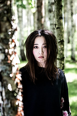 Female Asian in birch forest - p958m1446323 by KL23