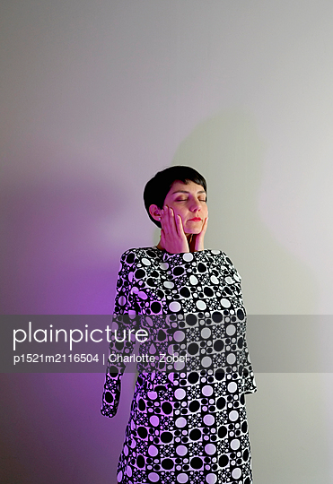 Woman wearing spotted dress - p1521m2116504 by Charlotte Zobel