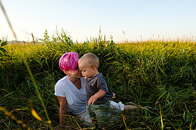 Young woman with son in a field - p1363m2258716 by Valery Skurydin