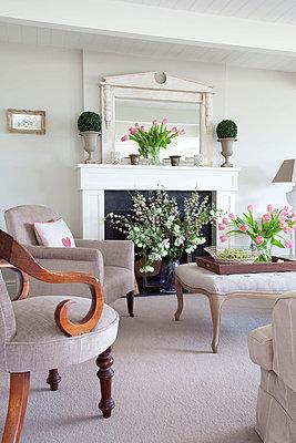 Cut flowers in living room of Sussex home  UK - p3493566 by Robert Sanderson