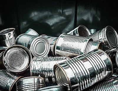 Close up of pile of aluminum cans - p429m662192f by Dan Brownsword