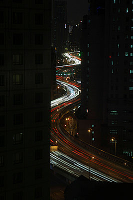 Winding Road in the City by Night - p664m822543 by Yom Lam