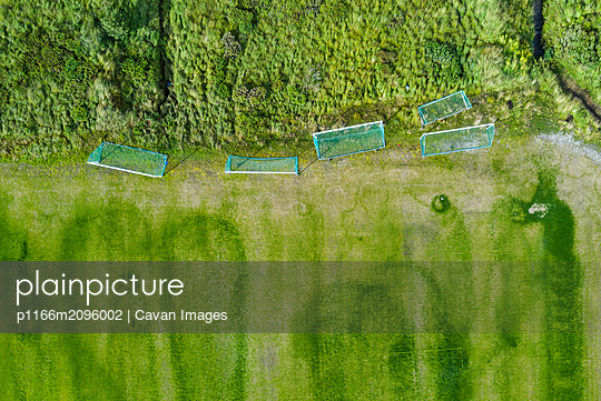 Football gates near field and trees - p1166m2096002 by Cavan Images
