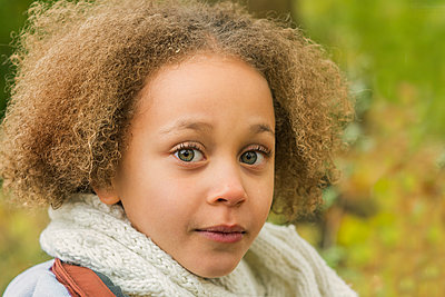 Portrait of a girl in a park, Autumn - p1323m1190225 by Sarah Toure