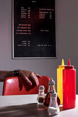 In a café - p504m851013 by JulianWard