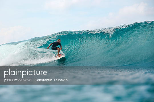 Surfer riding wave, Sumbawa, Indonesia - p1166m2202328 by Konstantin Trubavin