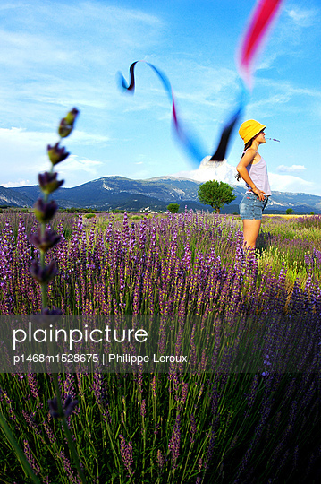Girl in lavender field - p1468m1528675 by Philippe Leroux