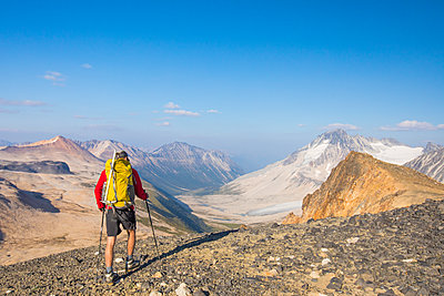 backpacker approaches view of Athelney Pass, British Columbia, Canada - p1166m2153412 by Cavan Images